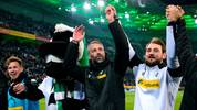 Moenchengladbach's German head coach Marco Rose (C) celebrates with team members and the mascot after the German first division Bundesliga football match Borussia Moenchengladbach vs Bayern Munich in Moenchengladbach, western Germany, on December 7, 2019. (Photo by UWE KRAFT / AFP) / DFL REGULATIONS PROHIBIT ANY USE OF PHOTOGRAPHS AS IMAGE SEQUENCES AND/OR QUASI-VIDEO (Photo by UWE KRAFT/AFP via Getty Images)