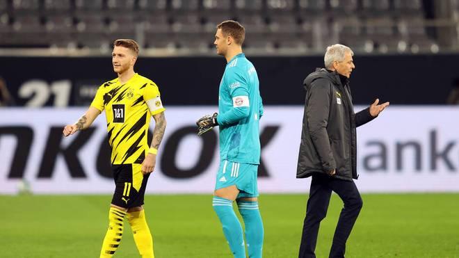 Manuel Neuer (M) wird vom BVB auf den Arm genommen