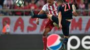 Olympiakos' Moroccan forward Youssef El-Arabi (L) scores a goal during the UEFA Champions League group B football match between Olympiacos FC and FC Bayern Munchen on October 22, 2019 at the Georgios Karaiskakis stadium in Piraeus near Athens, on October 22, 2019. (Photo by LOUISA GOULIAMAKI / AFP) (Photo by LOUISA GOULIAMAKI/AFP via Getty Images)