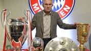Bayern Munich's head coach Jupp Heynckes poses with four trophy's after giving his farewell press conference in Munich, southern Germany, on June 4, 2013. Heynckes spoke about his future after he won with his team the UEFA Champions League, the German Football Cup (DFB-Pokal), the Super Cup and the Bundesliga German League during the season 2012/2013.     AFP PHOTO / CHRISTOF STACHE        (Photo credit should read CHRISTOF STACHE/AFP via Getty Images)