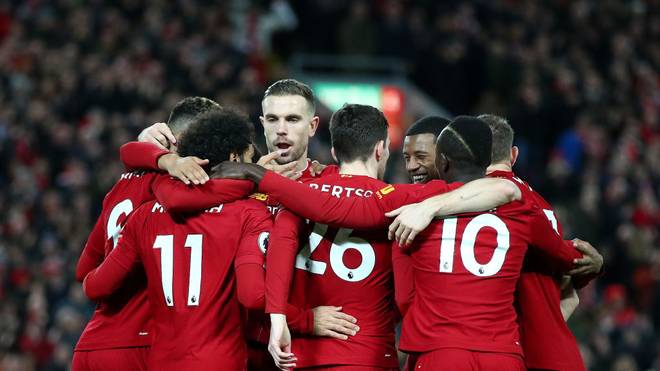 LIVERPOOL, ENGLAND - JANUARY 02: Mohamed Salah of Liverpool celebrates with his team mates after scoring his team's first goal during the Premier League match between Liverpool FC and Sheffield United at Anfield on January 02, 2020 in Liverpool, United Kingdom. (Photo by Clive Brunskill/Getty Images)