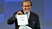 GENEVA, SWITZERLAND - SEPTEMBER 19:  UEFA President Michel Platini holds up the card for Baku who will host a quarter-final of the EURO 2020 during the UEFA EURO 2020 Host Cities & Final announcement ceremony held at Espace Hippomene on September 19, 2014 in Geneva, Switzerland.  (Photo by Harold Cunningham/Getty Images for UEFA)