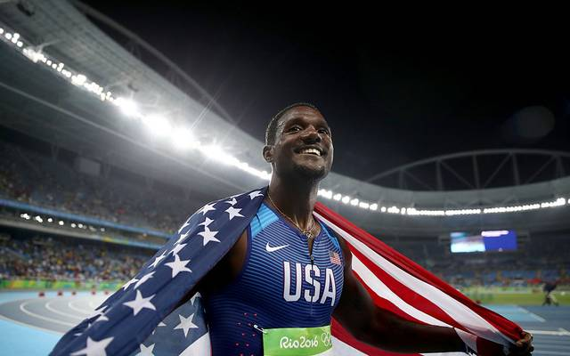 RIO DE JANEIRO, BRAZIL - AUGUST 19:  Justin Gatlin of the United States celebrates prior to being disqualified after the Men's 4 x 100m Relay Final on Day 14 of the Rio 2016 Olympic Games at the Olympic Stadium on August 19, 2016 in Rio de Janeiro, Brazil. The United States was disqualified for exchanging outside the zone in the first handoff.  (Photo by Cameron Spencer/Getty Images)
