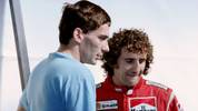 Brazilian Formula One driver Ayrton Senna (L) chats with French Alain Prost at his pits during the Belgian Grand Prix on August 28, 1988. (Photo by - / AFP)        (Photo credit should read -/AFP/Getty Images)