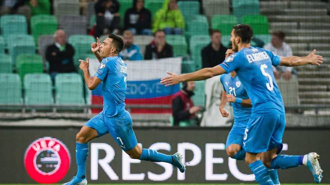 Israel's midfielder Eran Zahavi (L) celebrates after scoring a goal during the UEFA Euro 2020 Group G qualifying football match between Slovenia and Israel at the Stozice stadium in Ljubljana, Slovenia, on September 9, 2019. (Photo by Jure Makovec / AFP)        (Photo credit should read JURE MAKOVEC/AFP/Getty Images)