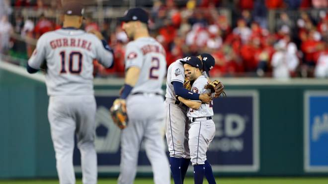 WASHINGTON, DC - OCTOBER 25:  Carlos Correa #1 and Jose Altuve #27 of the Houston Astros celebrate after the Astros defeated the Washington Nationals in Game 3 of the 2019 World Series at Nationals Park on Friday, October 25, 2019 in Washington, District of Columbia. (Photo by Alex Trautwig/MLB Photos via Getty Images)
