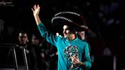 Switzerland's Roger Federer holds a Mexican hat and a trophy at the exhibition tennis singles match against Germany's Alexander Zverev in Mexico City, on November 23, 2019. (Photo by CLAUDIO CRUZ / AFP) (Photo by CLAUDIO CRUZ/AFP via Getty Images)