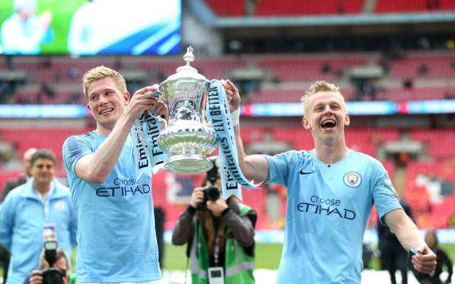 LONDON, ENGLAND - MAY 18:  Kevin De Bruyne and Oleksandr Zinchenko of Manchester City celebrate with the trophy after victory in the FA Cup Final match between Manchester City and Watford at Wembley Stadium on May 18, 2019 in London, England. (Photo by Alex Morton/Getty Images)