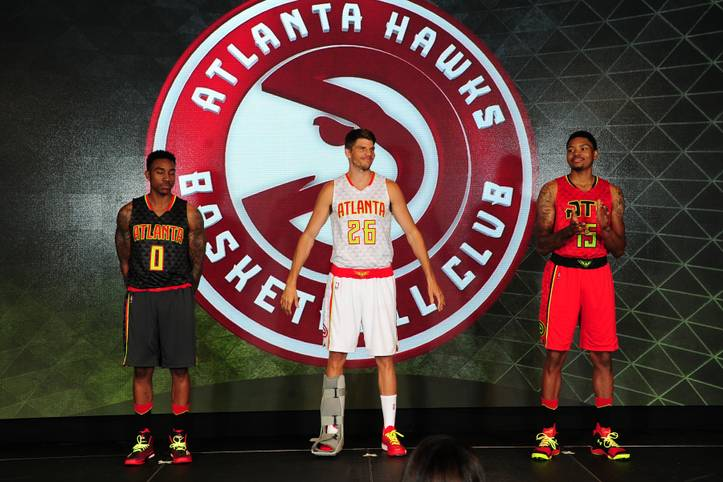 ATLANTA, GA - JUNE 24: Jeff Teague #0, Kyle Korver #26, and Kent Bazemore of the Atlanta Hawks model the Hawks new uniform on June 24, 2015 at Philips Arena in Atlanta, Georgia.  NOTE TO USER: User expressly acknowledges and agrees that, by downloading and/or using this Photograph, user is consenting to the terms and conditions of the Getty Images License Agreement. Mandatory Copyright Notice: Copyright 2015 NBAE (Photo by Scott Cunningham/NBAE via Getty Images)