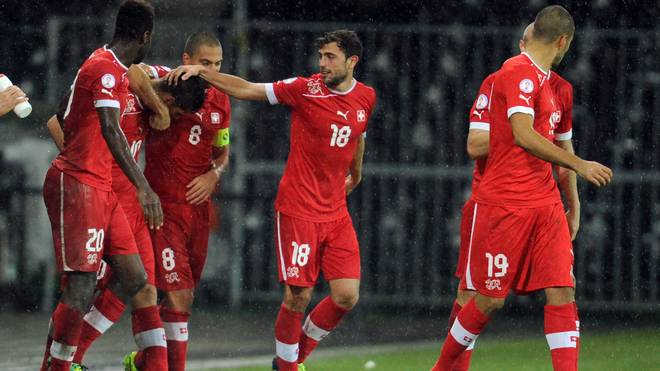 Switzerland's midfielder Granit Xhaka (2nd L) jubilates after scoring a goal during the 2014 FIFA World Cup qualifying football match between Switzerland and Slovenia on October 15, 2013, at the Stade de Suisse in Bern. AFP PHOTO / SEBASTIEN BOZON        (Photo credit should read SEBASTIEN BOZON/AFP via Getty Images)