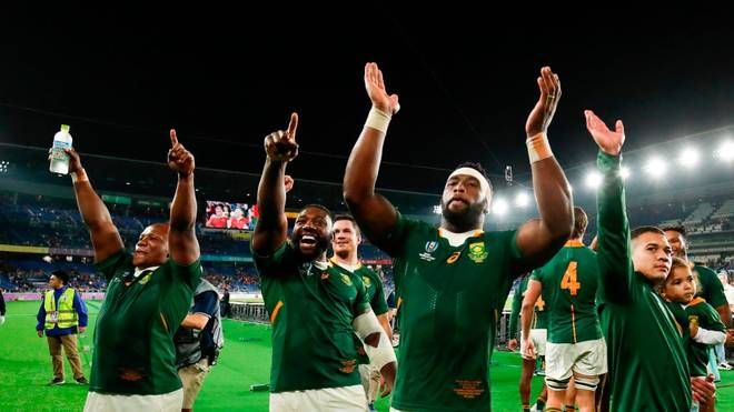 South Africa's players celebrate winning the Japan 2019 Rugby World Cup semi-final match between Wales and South Africa at the International Stadium Yokohama in Yokohama on October 27, 2019. (Photo by Behrouz MEHRI / AFP) (Photo by BEHROUZ MEHRI/AFP via Getty Images)