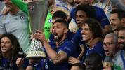 TOPSHOT - Chelsea's French striker Olivier Giroud (C)  holds the trophy as he celebrates with teammates after winning  the UEFA Europa League final football match between Chelsea FC and Arsenal FC at the Baku Olympic Stadium in Baku, Azerbaijian, on May 29, 2019. (Photo by OZAN KOSE / AFP)        (Photo credit should read OZAN KOSE/AFP via Getty Images)