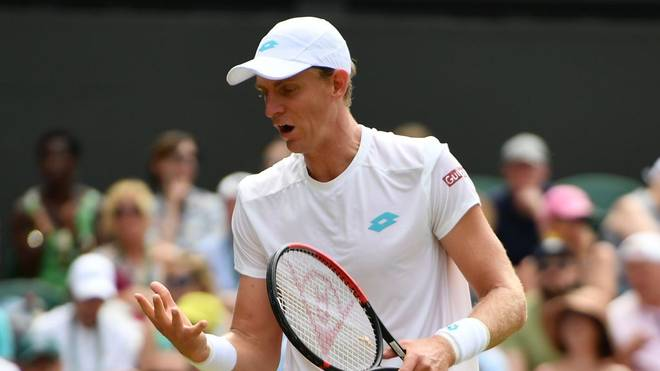 South Africa's Kevin Anderson reacts after a point against Argentina's Guido Pella during their men's singles third round match on the fifth day of the 2019 Wimbledon Championships at The All England Lawn Tennis Club in Wimbledon, southwest London, on July 5, 2019. (Photo by Daniel LEAL-OLIVAS / AFP) / RESTRICTED TO EDITORIAL USE        (Photo credit should read DANIEL LEAL-OLIVAS/AFP/Getty Images)