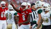 Lamar Jackson of the Louisville Cardinals signals a first down during the game against the Charlotte 49ers