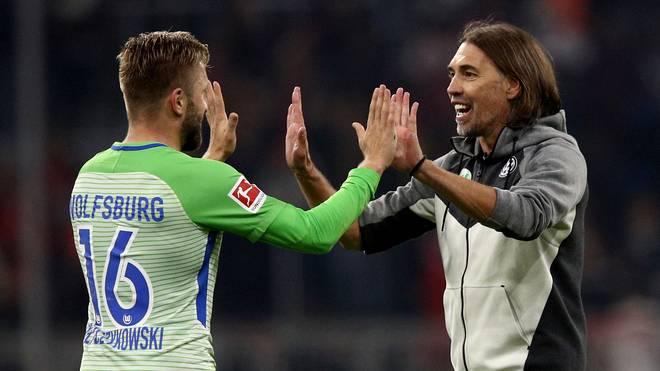 Martin Schmidt und Jakub Blaszczykowski bejubeln das Unentschieden bei den Bayern