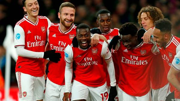 Arsenal's French-born Ivorian midfielder Nicolas Pepe (C) celebrates with teammates after scoring their second goal during the English Premier League football match between Arsenal and Newcastle United at the Emirates Stadium in London on February 16, 2020. (Photo by Ian KINGTON / AFP) / RESTRICTED TO EDITORIAL USE. No use with unauthorized audio, video, data, fixture lists, club/league logos or 'live' services. Online in-match use limited to 120 images. An additional 40 images may be used in extra time. No video emulation. Social media in-match use limited to 120 images. An additional 40 images may be used in extra time. No use in betting publications, games or single club/league/player publications. /  (Photo by IAN KINGTON/AFP via Getty Images)