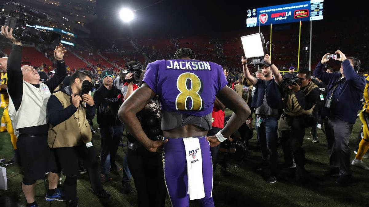 Lamar Jackson #8 of the Baltimore Ravens answers questions from the media after a game against the Los Angeles Rams