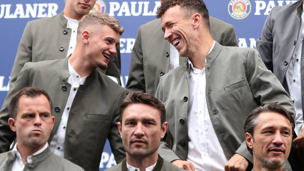 MUNICH, GERMANY - SEPTEMBER 01: Michael Cuisance (L) and Ivan Perisic of FC Bayern Muenchen laugh during the FC Bayern Muenchen and Paulaner photo session at FGV Schmidtle Studios on September 01, 2019 in Munich, Germany. (Photo by Alexandra Beier/Bongarts/Getty Images)