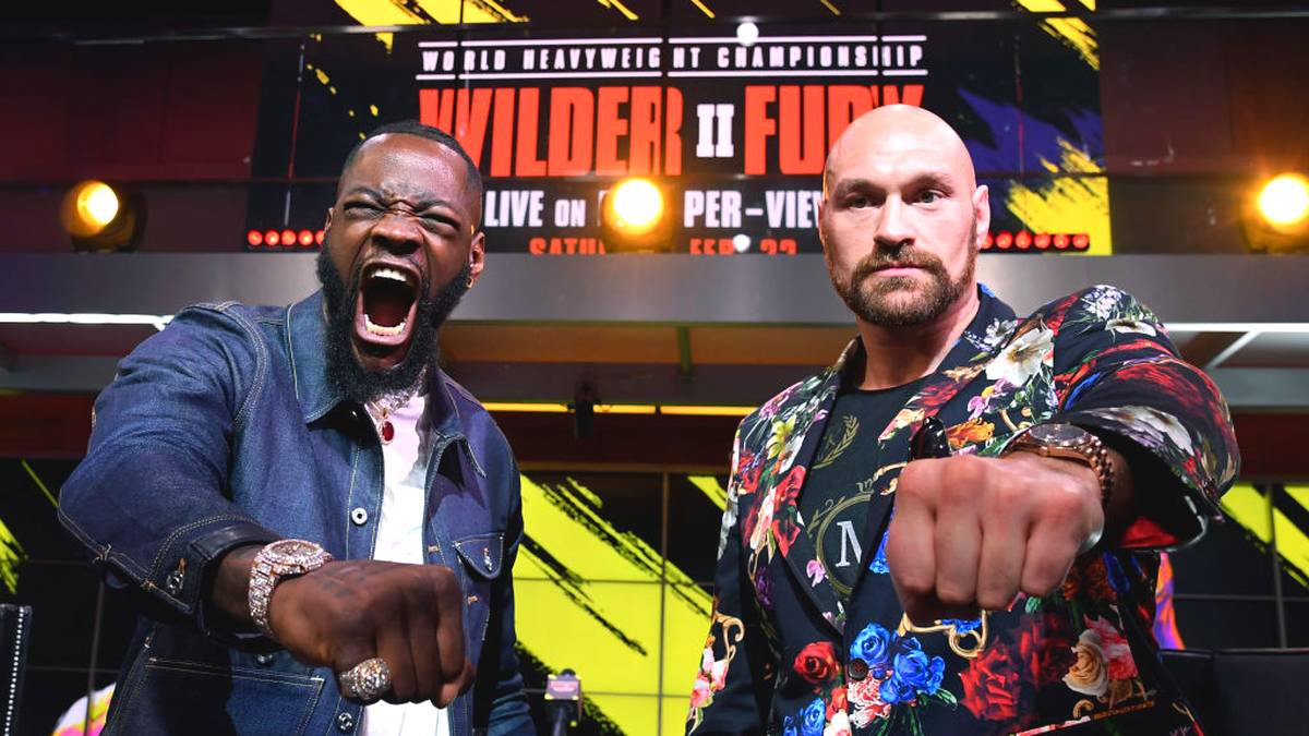 LOS ANGELES, CA - JANUARY 25: Deontay Wilder (L) and Tyson Fury face off during a news conference at Fox Studios on January 25, 2020 in Los Angeles, California. (Photo by Kevork Djansezian/Getty Images)