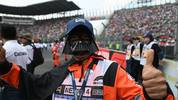 A track marshal wearing a costume is pictured prior to the start of the F1 Mexico Grand Prix at the Hermanos Rodriguez racetrack in Mexico City on October 27, 2019. (Photo by PEDRO PARDO / AFP) (Photo by PEDRO PARDO/AFP via Getty Images)