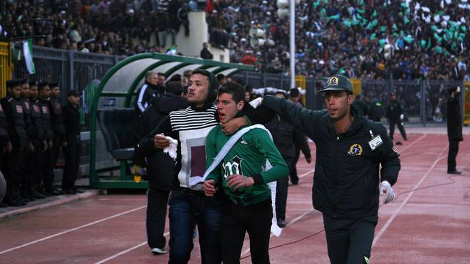 A wounded Egyptian fan of Al-Masry is es