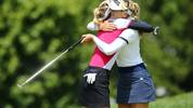 MIDLAND, MI - JULY 17: (L-R) Nelly Korda embraces Jessica Korda on the 9th hole after their the first round of the Dow Great Lakes Bay Invitational at Midland Country Club on July 17, 2019 in Midland, Michigan. (Photo by Rey Del Rio/Getty Images)