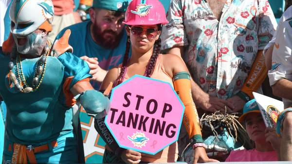 """MIAMI, FL - OCTOBER 13: A Miami Dolphins fan holds a sign that reads """"Stop Tanking"""" during the game against the Washington Redskins at Hard Rock Stadium on October 13, 2019 in Miami, Florida. (Photo by Eric Espada/Getty Images)"""