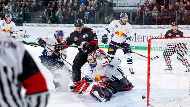 Die Nürnberg Ice Tigers (schwarz) gewinnen das DEL-Topspiel gegen München