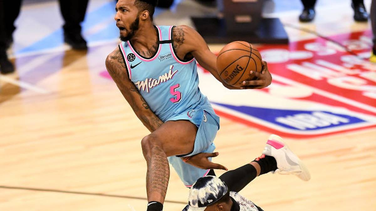 CHICAGO, ILLINOIS - FEBRUARY 15: Derrick Jones Jr. #5 of the Miami Heat leaps over Bam Adebayo #13 of the Miami Heat in the 2020 NBA All-Star - AT&T Slam Dunk Contest during State Farm All-Star Saturday Night at the United Center on February 15, 2020 in Chicago, Illinois. NOTE TO USER: User expressly acknowledges and agrees that, by downloading and or using this photograph, User is consenting to the terms and conditions of the Getty Images License Agreement. (Photo by Stacy Revere/Getty Images)