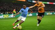 WOLVERHAMPTON, ENGLAND - DECEMBER 27: Raheem Sterling of Manchester CIty is closed down by Conor Coady of Wolverhampton Wanderers during the Premier League match between Wolverhampton Wanderers and Manchester City at Molineux on December 27, 2019 in Wolverhampton, United Kingdom. (Photo by Shaun Botterill/Getty Images)