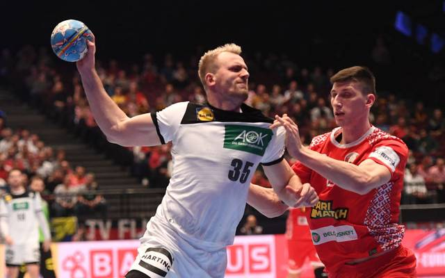 Viachaslau Bokhan of Belarus (r) blocks Julius Kuhn of Germany during the Men's European Handball Championship, main round match between Belarus and Germnay in Vienna, Austria on January 16, 2020. (Photo by JOE KLAMAR / AFP) (Photo by JOE KLAMAR/AFP via Getty Images)