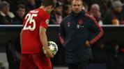 MUNICH, GERMANY - NOVEMBER 06: Hans-Dieter Flick, Interim Head Coach of FC Bayern Munich reacts with his player Thomas Müller during the UEFA Champions League group B match between Bayern Muenchen and Olympiacos FC at Allianz Arena on November 06, 2019 in Munich, Germany. (Photo by Alexander Hassenstein/Bongarts/Getty Images)