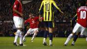 MANCHESTER, UNITED KINGDOM:  Manchester United's  Wayne Rooney scores his 3rd goal against Fenerbahce's during their Champion's League football match at Old Trafford, Manchester 28 September 2004.    AFP PHOTO/PAUL BARKER       (Photo credit should read PAUL BARKER/AFP via Getty Images)