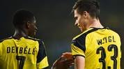 Dortmund's midfielder Julian Weigl (R) celebrates with his teammate Dortmund's French forward Ousmane Dembele (L) after scoring during the UEFA Champions League football match Sporting CP vs BVB Borussia Dortmund at the Jose Alvalade stadium in Lisbon on October 18, 2016. / AFP / PATRICIA DE MELO MOREIRA        (Photo credit should read PATRICIA DE MELO MOREIRA/AFP via Getty Images)