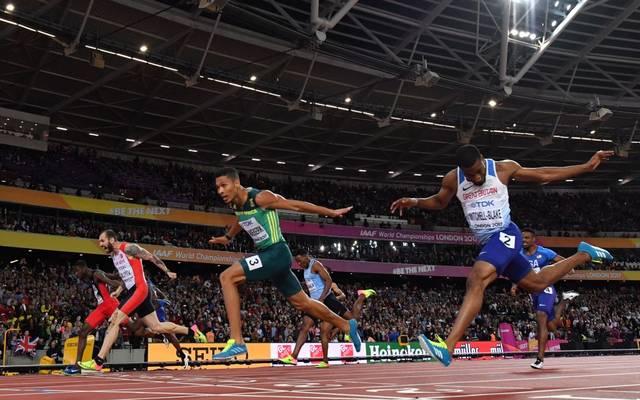 Wayde Van Niekerk (M.) ist aktuell der schnellste 400-Meter-Läufer der Welt