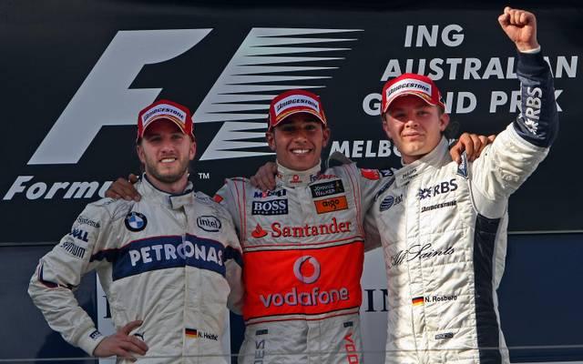 Britain's Lewis Hamilton (C) shares the