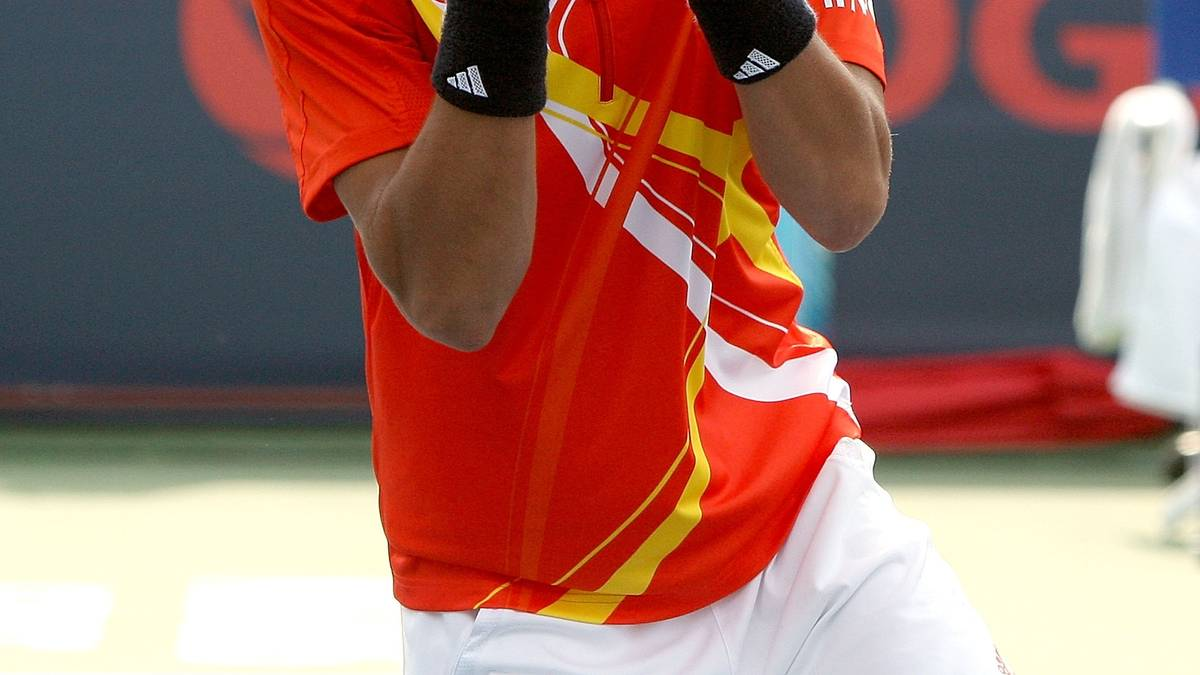 MONTREAL, QC - AUGUST 12:  Novak Djokovic of Serbia celebrates match point against Roger Federer of Switzerland during the final of the Coupe Rogers August 12, 2007 at Stade Uniprix in Montreal, Quebec, Canada.  (Photo by Matthew Stockman/Getty Images)