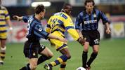 9 May 1999:  Faustino Asprilla of Parma in action against Dario Simic and Benoit Cauet of Inter Milan during the Serie A match against Inter Milan played at the San Siro Stadium in Milan, Italy.  The match finished in a 1-3 win for Parma.   \ Mandatory Credit: Allsport UK /Allsport