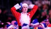 LONDON, ENGLAND - DECEMBER 23: A fan in fancy dress reacts as they watch the Third Round match between Jeffrey de Zwaan of The Netherlands and Dave Chisnall of England during Day Eleven of the 2020 William Hill World Darts Championship at Alexandra Palace on December 23, 2019 in London, England. (Photo by Alex Burstow/Getty Images)