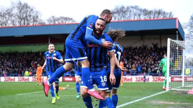 ROCHDALE, ENGLAND - JANUARY 04: Aaron Wilbraham of Rochdale celebrates with teammates after scoring his team's first goal during the FA Cup Third Round match between Rochdale AFC and Newcastle United at Spotland Stadium on January 04, 2020 in Rochdale, England. (Photo by Laurence Griffiths/Getty Images)