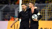 Dortmund's German forward Marco Reus (R) is congratulated by Dortmund's Portuguese defender Raphael Guerreiro after scoring the 1-0 during the German first division Bundesliga football match Borussia Dortmund v Fortuna Duesseldorf in Dortmund, western Germany on December 7, 2019. (Photo by INA FASSBENDER / AFP) / DFL REGULATIONS PROHIBIT ANY USE OF PHOTOGRAPHS AS IMAGE SEQUENCES AND/OR QUASI-VIDEO (Photo by INA FASSBENDER/AFP via Getty Images)