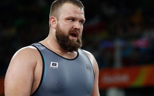 Germany's Eduard Popp reacts as he wrestles with Iran's Bashir Asgari Babajanzadeh Darzi in their men's 130kg greco-roman quarter-final match on August 15, 2016, during the wrestling event of the Rio 2016 Olympic Games at the Carioca Arena 2 in Rio de Janeiro. / AFP / Jack GUEZ        (Photo credit should read JACK GUEZ/AFP/Getty Images)