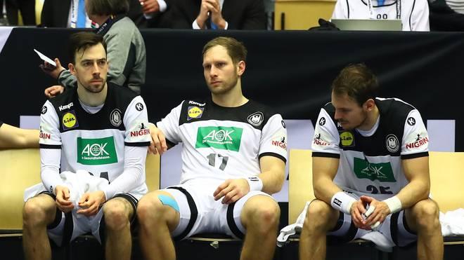 Patrick Grötzki, Steffen Weinhold und Kai Häfner (v.l.) lassen enttäuscht die Köpfe hängen