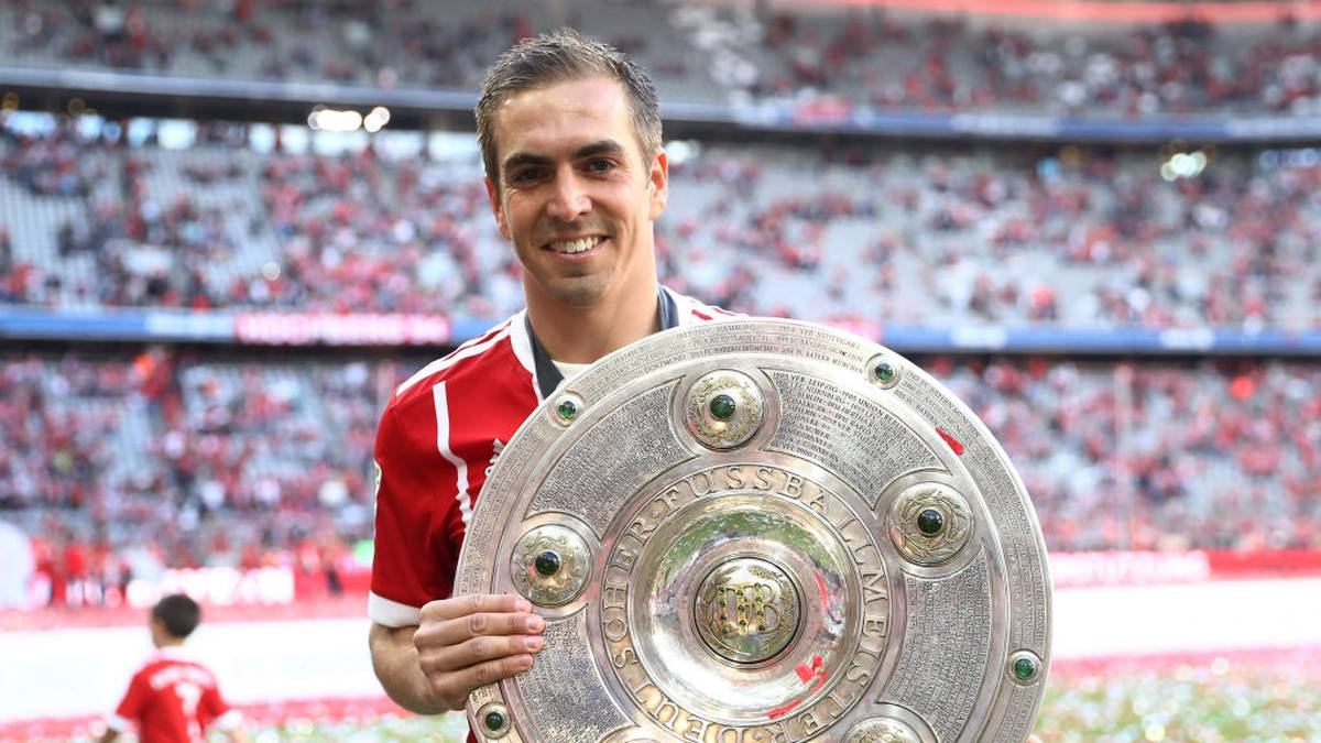 MUNICH, GERMANY - MAY 20:  Philipp Lahm of Bayern Muenchen poses with the Championship trophy in celebration of the 67th German Championship title following the Bundesliga match between Bayern Muenchen and SC Freiburg at Allianz Arena on May 20, 2017 in Munich, Germany.  (Photo by Alexander Hassenstein/Bongarts/Getty Images)