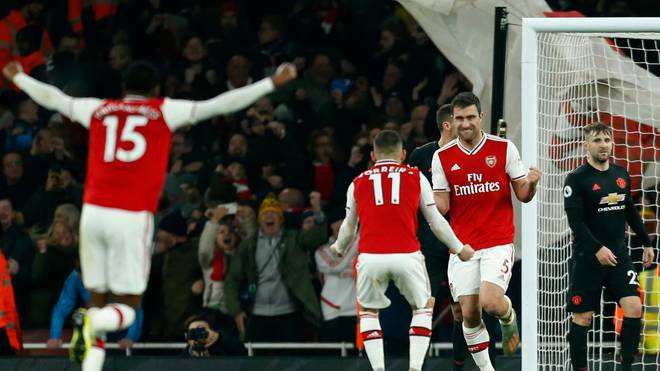 Arsenal's Greek defender Sokratis Papastathopoulos (2nd R) celebrates with teammates after scoring their second goal during the English Premier League football match between Arsenal and Manchester United at the Emirates Stadium in London on January 1, 2020. (Photo by Ian KINGTON / IKIMAGES / AFP) / RESTRICTED TO EDITORIAL USE. No use with unauthorized audio, video, data, fixture lists, club/league logos or 'live' services. Online in-match use limited to 45 images, no video emulation. No use in betting, games or single club/league/player publications. (Photo by IAN KINGTON/IKIMAGES/AFP via Getty Images)