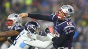 Tom Brady of the New England Patriots passes under pressure from Harold Landry of the Tennessee Titans in the second half of the AFC Wild Card Playoff game at Gillette Stadium