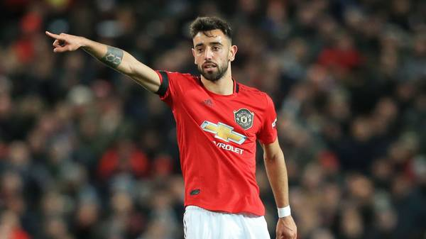 Manchester United's Portuguese midfielder Bruno Fernandes gestures during the English Premier League football match between Manchester United and Wolverhampton Wanderers at Old Trafford in Manchester, north west England, on February 1, 2020. (Photo by Lindsey Parnaby / AFP) / RESTRICTED TO EDITORIAL USE. No use with unauthorized audio, video, data, fixture lists, club/league logos or 'live' services. Online in-match use limited to 120 images. An additional 40 images may be used in extra time. No video emulation. Social media in-match use limited to 120 images. An additional 40 images may be used in extra time. No use in betting publications, games or single club/league/player publications. /  (Photo by LINDSEY PARNABY/AFP via Getty Images)