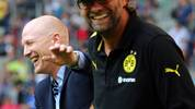 HAMBURG, GERMANY - AUGUST 04:  Juergen Klopp (R), head coach of Borussia Dortmund jokes with Matthias Sammer (L), sport director of Bayern Muenchen before the LIGA total! Cup Semi final match between Bayern Muenchen and Werder Bremen at Imtech Arena on August 4, 2012 in Hamburg, Germany.  (Photo by Martin Rose/Bongarts/Getty Images)