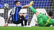 Inter Milan's Argentinian forward Lautaro Martinez (L) gets back up after opening the scoring past Dortmund's Swiss goalkeeper Roman Buerki (R) during the UEFA Champions League Group F football match Inter Milan vs Borussia Dortmund on October 23, 2019 at the San Siro stadium in Milan. (Photo by Miguel MEDINA / AFP) (Photo by MIGUEL MEDINA/AFP via Getty Images)