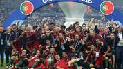 Portugal's forward Cristiano Ronaldo (C) and teammates pose with the trophy as they celebrate after beating France during the Euro 2016 final football match at the Stade de France in Saint-Denis, north of Paris, on July 10, 2016. / AFP / Valery HACHE        (Photo credit should read VALERY HACHE/AFP/Getty Images)